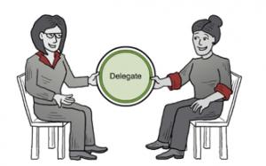 Delegator_TwoWomenPassingDelegationCircle